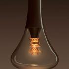 vietidlo poskytuje osvetlenie porovnateľné s tradičnou 60W žiarovkou, zatiaľ čo teplé svetlo po stranách zdobí žiarovku2